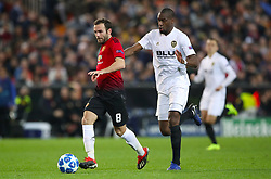Manchester United's Juan Mata and Valencia's Geoffrey Kondogbia battle for the ball