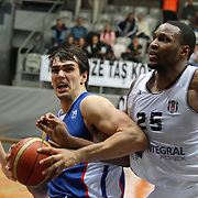 Besiktas integral Forex's Hilton Armstrong (R) and Anadolu Efes's Dario Saric (C) during their Turkish basketball league match Besiktas integral Forex between Anadolu Efes at BJK Akatlar Arena in Istanbul, Turkey, Monday, January 05, 2015. Photo by TURKPIX