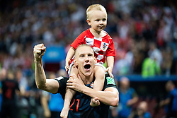 July 11, 2018 - Moscow, Russia - 180711 Domagoj Vida of Croatia celebrate with his child after winning the FIFA World Cup semi final match between Croatia and England on July 11, 2018 in Moscow..Photo: Petter Arvidson / BILDBYRÃ…N / kod PA / 92085 (Credit Image: © Petter Arvidson/Bildbyran via ZUMA Press)