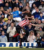 Photo: Glyn Thomas.<br />Birmingham City v Sunderland. The Barclays Premiership. 25/02/2006.<br />Birmingham's DJ Campbell (L) battles for the ball with Gary Breen.
