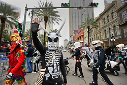 17 Feb 2015. New Orleans, Louisiana.<br /> Mardi Gras Day. Walking with Skeletons. <br /> Crossing Canal Street. The Skeleton Krewe meets before dawn beside a cemetery in Uptown New Orleans. They then walk several miles Along Saint Charles Avenue to the French Quarter to celebrate Mardi Gras Day.<br /> Photo; Charlie Varley/varleypix.com