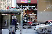 5th avenue New York City street view seen through a window with tourist doubledecker bus