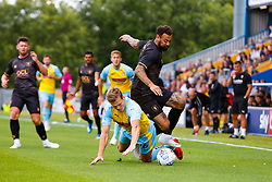 Shaun Raggett of Rotherham United takes down Tyler Walker of Mansfield Town in a challenge for possession - Mandatory by-line: Ryan Crockett/JMP - 28/07/2018 - FOOTBALL - One Call Stadium - Mansfield, England - Mansfield Town v Rotherham United - Pre-season friendly