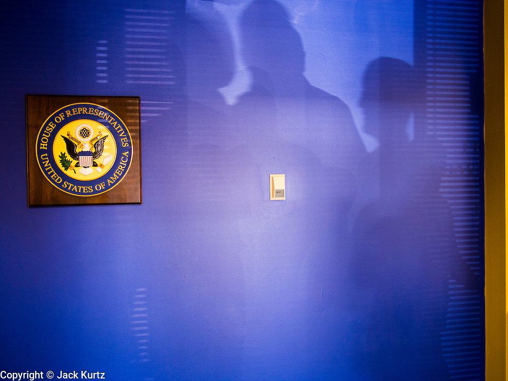 09 NOVEMBER 2013 - PHOENIX, AZ: People's shadows on the wall in the district office of Congressman David Schweikert in Scottsdale. Congressman Schweikert represents Arizona's 6th Congressional District. Most of the district is in Scottsdale, a wealthy suburb of Phoenix and one of the wealthiest cities in the United States. Schweikert is a staunch conservative and popular with the Tea Party. He supported the government shutdown in October.    PHOTO BY JACK KURTZ