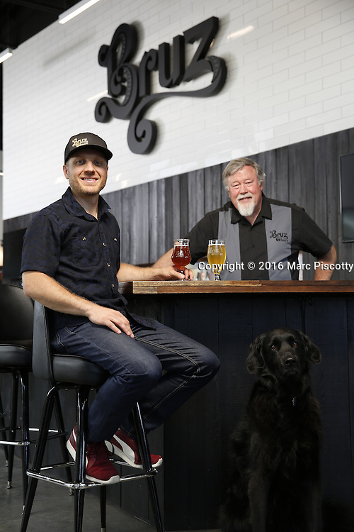 SHOT 7/22/16 1:44:07 PM - Bruz Beers co-founders Charlie Gottenkieny and Ryan Evans inside the new brewery near 67th Avenue and Pecos in Denver, Co. Bruz Beers is Denver's artisanal Belgian-style brewery, featuring a full line of traditional and Belgian-inspired brews, hand-crafted in small batches. Includes images of Evan's dog 'Cooper' as well who serves as the brewery dog. (Photo by Marc Piscotty / © 2016)