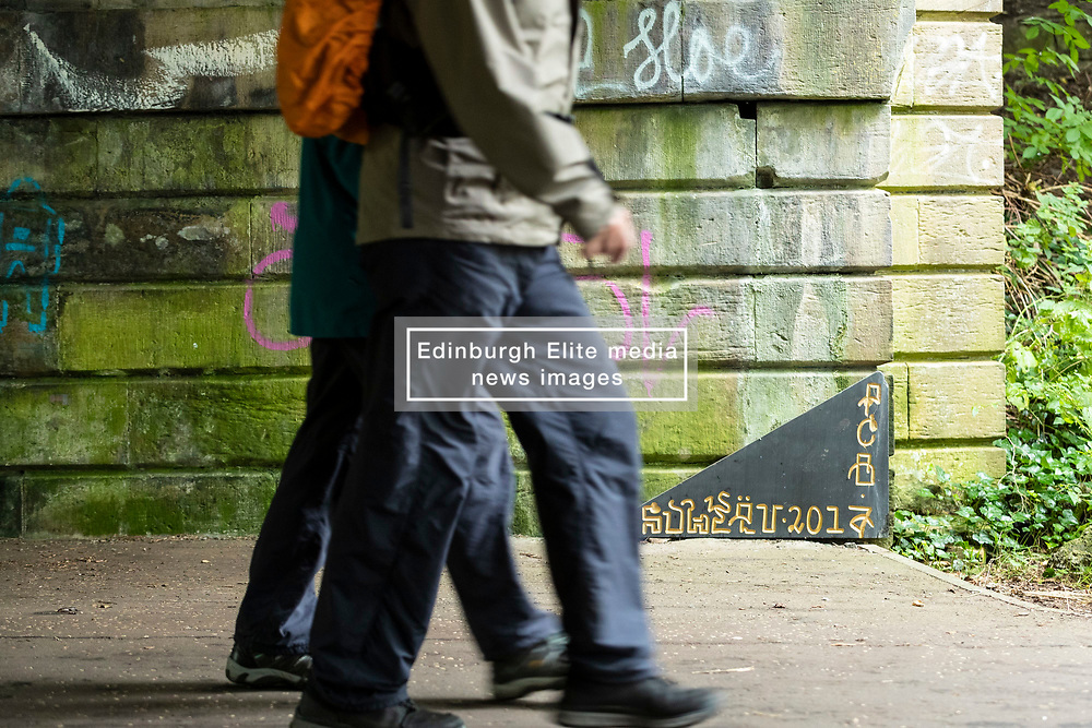 Edinburgh's graffiti artists have taken their tagging exploits to a new level by swapping their paints for pieces of marble and granite. The name of Youtz is daubed around the city on walls but now it has appeared along with other graffiti artists 'tags' on the walls of a bridge intricately carved into pieces of granite and marble and then stuck onto the wall.
