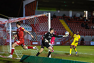 Walsall goalkeeper Liam Roberts (#1) keeps the ball in play after Crawley Town forward James Tilley (#38) heads at goal during the EFL Sky Bet League 2 match between Crawley Town and Walsall at The People's Pension Stadium, Crawley, England on 16 March 2021.
