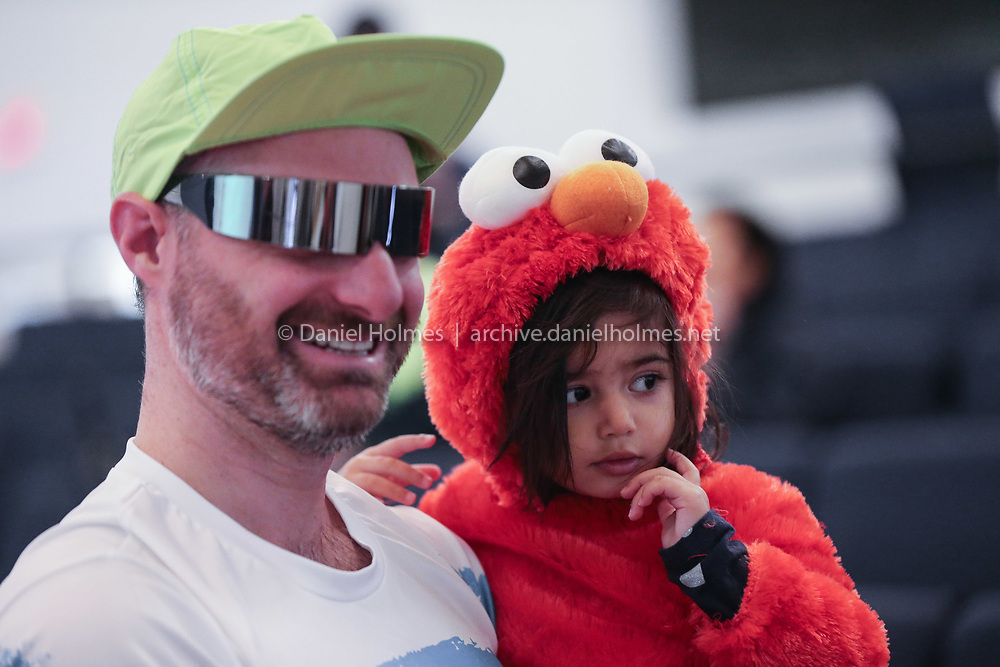 (10/27/19, HOPKINTON, MA) Lua Newby, 2, and her dad Peter wait foe the start of the third annual Enter Stage Left Wicked 5K at Hopkinton Center for the Arts on Sunday. [Daily News and Wicked Local Photo/Dan Holmes]
