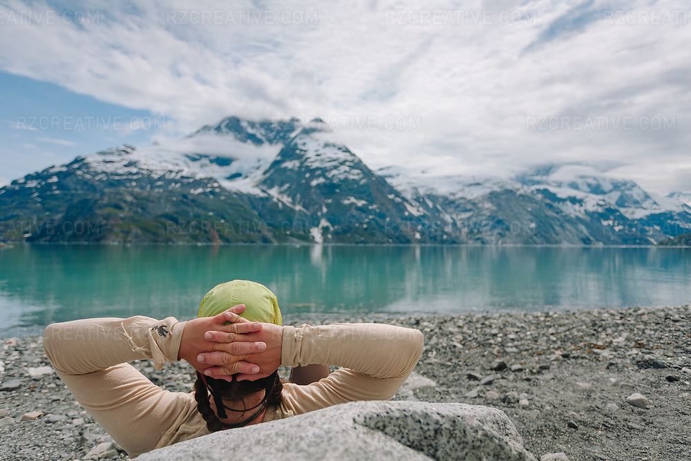 A woman enjoying a warm sunny day at Topeka beach in Johns Hopkins Inlet in southeast Alaska's Glacier Bay National Park and Preserve. Photo © Robert Zaleski / rzcreative.com<br /> —<br /> To license this image contact: robert@rzcreative.com