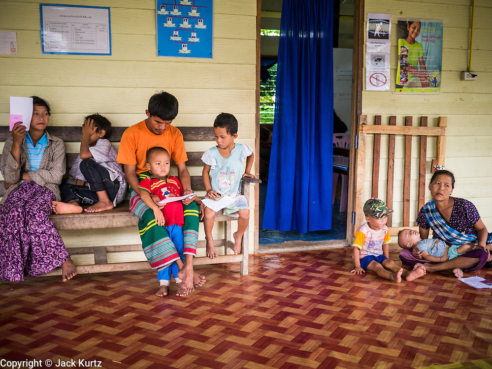21 MAY 2013 - MAE KU, TAK, THAILAND:  The outpatient waiting area at the SMRU clinic in Mae Ku. Health professionals are seeing increasing evidence of malaria resistant to artemisinin coming out of the jungles of Southeast Asia. Artemisinin has been the first choice for battling malaria in Southeast Asia for 20 years. In recent years though,  health care workers in Cambodia and Myanmar (Burma) are seeing signs that the malaria parasite is becoming resistant to artemisinin. Scientists who study malaria are concerned that history could repeat itself because chloroquine, an effective malaria treatment until the 1990s, first lost its effectiveness in Cambodia and Burma before spreading to Africa, which led to a spike in deaths there. Doctors at the Shaklo Malaria Research Unit (SMRU), which studies malaria along the Thai Burma border, are worried that artemisinin resistance is growing at a rapid pace. Dr. Aung Pyae Phyo, a Burmese physician at a SMRU clinic just a few meters from the Burmese border, said that in 2009, 90 percent of patients were cured with artemisinin, but in 2010, it dropped to about 70 percent and is now between 55 and 60 percent. He said the concern is that as it becomes more difficult to clear the parasite from a patient, progress that has been made in combating malaria will be lost and the disease could make a comeback in Southeast Asia.  PHOTO BY JACK KURTZ