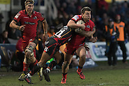 Damien Hoyland of Edinburgh drives through the tackle of Ashton Hewitt of the Newport Gwent Dragons. Guinness Pro12 rugby match, Newport Gwent Dragons  v Edinburgh rugby at Rodney Parade in Newport, South Wales on Sunday 27th November 2016.<br /> pic by Simon Latham, Andrew Orchard sports photography.