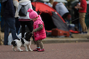 Child and dog celebrate their Queen's Diamond Jubilee weeks before the Olympics come to London. The UK enjoys a weekend and patriotic fervour as their monarch celebrates 60 years on the throne. Across Britain, flags and Union Jack bunting adorn towns and villages.