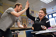 Junior Esmeralda Perez celebrates with tutor Ian Wessen of San Jose as they wrap up a successful tutoring session with her AP Physics homework during the EOS tutoring class during lunch at Milpitas High School in Milpitas, California, on October 13, 2014. (Stan Olszewski/SOSKIphoto)