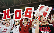 Feb 16, 2013; Fayetteville, AR, USA; Arkansas Razorbacks fans in the students section cheer during a game against the Missouri Tigers at Bud Walton Arena. Arkansas defeated Missouri 73-71. Mandatory Credit: Beth Hall-USA TODAY Sports