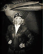 A young model posing as a late twenties aviatrix with an American Eagle 101 at WAAAM.