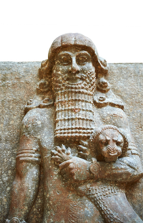 Stone statue of a Hero holding a lion. From facade M of the palace courtyard ,  Inv AO 19861 from Dur Sharrukin the palace of Assyrian king Sargon II at Khorsabad, 713-706 BC.  Louvre Museum Room 4 , Paris .<br /> <br /> If you prefer to buy from our ALAMY PHOTO LIBRARY  Collection visit : https://www.alamy.com/portfolio/paul-williams-funkystock/ancient-assyria-antiquities.html  Refine search by adding background colour, place, subject, museum etc into the LOWER SEARCH WITHIN GALLERY box to <br /> <br /> Visit our ANCIENT ASSYRIAN PHOTO COLLECTIONS for more photos to download or buy as wall art prints https://funkystock.photoshelter.com/gallery-collection/Ancient-Assyrian-Art-Artefacts-Antiquities-Historic-Sites-Pictures-Images-of/C0000cjRqQyJjLag