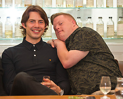 Pictured: Will Rastall and Stephen Brandon<br /> <br /> Some of the cast and those behind the scenes of My Feral Heart gathered in the Scotch Whisky Society in Edinburgh to relax ahead of the UK Premier of their film at the Edinburgh International Film Festival. Directed by Jane Gull, My Feral Heart stars Stephen Brandon in his debut as Luke, Will Rastall, Shana Swash, Eileen Polliock, Suzanna Hamilton and Pixie Le Knot.<br /> <br /> When Luke, an independent and sensitive young man with Down's syndrome is forced to live in a care home after his elderly mother dies, he struggles to settle. Frustrated by having his wings clipped by unfamiliar rules; totally unimpressed by his new housemates and grieving for his Mum - his disappointment soon turns to wonder when Luke discovers a way out and begins to explore the surrounding countryside. When he is caught sneaking out by Pete, a troubled youth who tends the gardens at the Home, they strike up an unlikely rapport: Pete covers for Luke when he sneaks out and in return Luke helps Pete clear the garden. On an illicit excursion to the adjoining field Luke discovers a young injured girl in desperate need of his help.<br /> <br /> <br /> Ger Harley | EEm 17 June  2016