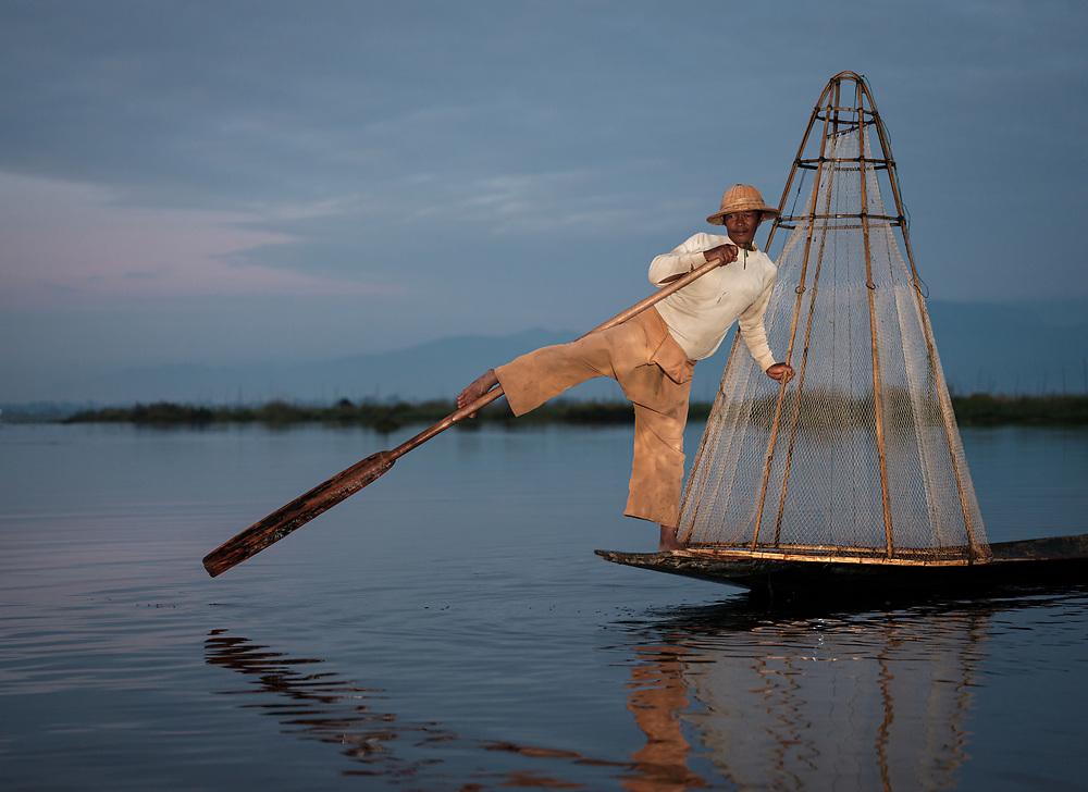 INLE LAKE, MYANMAR - CIRCA DECEMBER 2017: Fisherman of Inle Lake, Myanmar