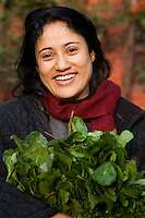Nepali Woman with Flowers, The population of Nepal is a mosaic of diverse ethnic groups lncluding the Thakali, Tamangs, Newar, Sherpa, Tibetans and Gurung. As such the country is meeting place of Indo Aryan peoples plus Mongoloid people from the Himalaya regions.