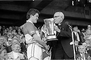 07/09/1986<br /> 09/07/1986<br /> 7 September 1986<br /> All-Ireland Senior and Minor Hurling Finals at Croke Park, Dublin.<br /> <br /> Dr. T. Morris, Archbishop of Cashell (right) patron of the G.A.A. presenting the Minor Hurling Cup to Michael Hogan, captain of the Offaly team.
