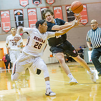 Gallup Bengal Quincy Smith (20), left, collides with Sandia Prep Sundevil Max Feit (20) during the Bengal Boys Basketball Invitational Tournament at Gallup High School Friday.