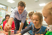© Licensed to London News Pictures. 01/05/2014. Surbiton, UK. Nick Clegg paints a picture of a leaf, caterpillar, and volcano  with children. Deputy Prime Minister Nick Clegg visits Lime Tree Primary School in Surbiton today 1st May 2014. Whilst there he took part in a painting, phonics and maths projects with school children. Photo credit : Stephen Simpson/LNP
