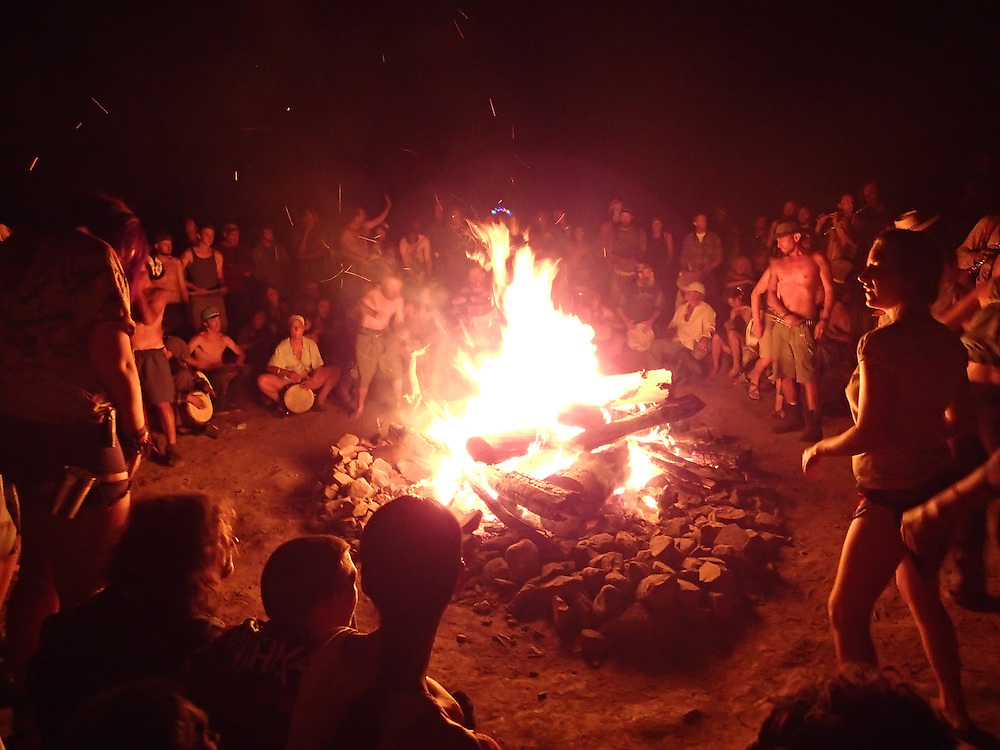 Main bonfire and drum circle ah the gathering.  Rainbow Gatherings started back in 1972, acts of self-expression, inclusiveness, and the right to peacefully assemble. Rainbow Gathering 2013 was held in Montana, outside of Jackson.