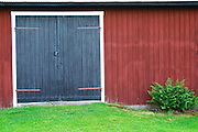 Traditional style Swedish wooden painted house. Black door. Barn Smaland region. Sweden, Europe.
