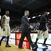 Central Florida head coach Donnie Jones walks off the court with Central Florida guard/forward Isaiah Sykes (32) and Central Florida forward David Diakite (15) during a Conference USA NCAA basketball game between the Rice Owls and the Central Florida Knights at the UCF Arena on January 22, 2011 in Orlando, Florida. Rice won the game 57-50 and extended the Knights losing streak to 4 games.  (AP Photo/Alex Menendez)