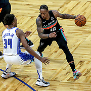 ORLANDO, FL - APRIL 12: DeMar DeRozan #10 of the San Antonio Spurs controls the ball as Wendell Carter Jr. #34 of the Orlando Magic plays defense during the first half at Amway Center on April 12, 2021 in Orlando, Florida. NOTE TO USER: User expressly acknowledges and agrees that, by downloading and or using this photograph, User is consenting to the terms and conditions of the Getty Images License Agreement. (Photo by Alex Menendez/Getty Images)*** Local Caption *** DeMar DeRozan; Wendell Carter Jr.