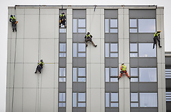 © Licensed to London News Pictures. 27/06/2017. London, UK. Specialists abseil down the face of Bray tower block to inspect and measure cladding on the Chalcots Estate in Camden after it failed a fire inspection because of combustable cladding. More than 700 flats in tower blocks on an estate in the Swiss Cottage area of north-west London are being evacuated because of fire safety concerns after the Grenfell Tower fire of on June 14. Photo credit: Peter Macdiarmid/LNP
