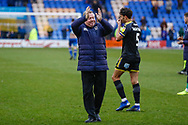 Wimbledon Manager Wally Downes applauds the fans during the EFL Sky Bet League 1 match between Shrewsbury Town and AFC Wimbledon at Greenhous Meadow, Shrewsbury, England on 2 March 2019.