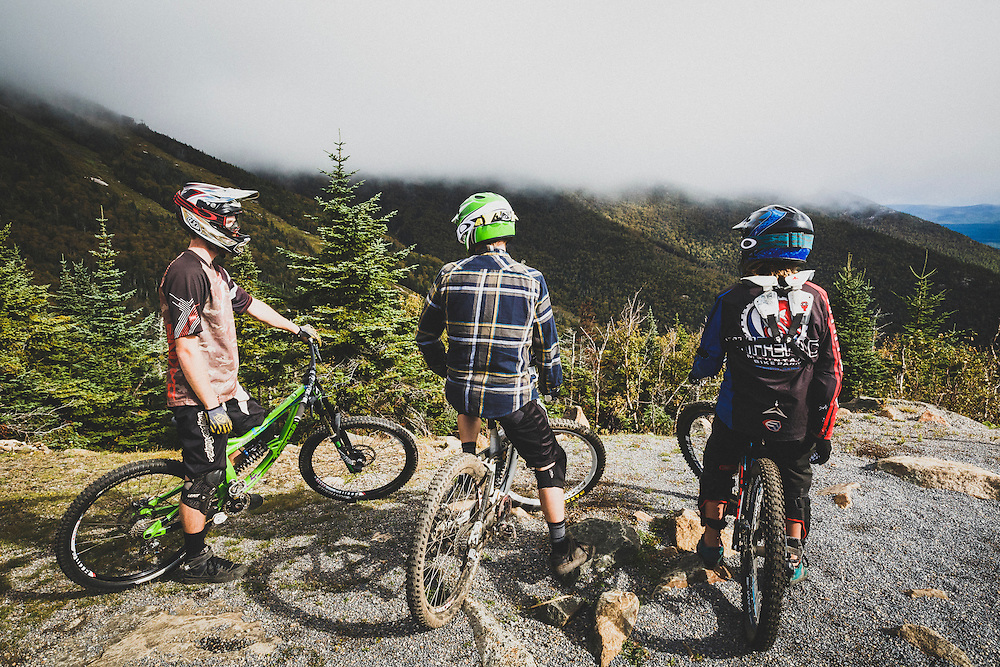 Eli Glesmann, Bill Frazer and Adrian Hayden look out from the top of Whiteface.