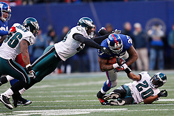 11 Jan 2009: Philadelphia Eagles defensive end Trent Cole #58 tackles New York Giants running back Brandon Jacobs #27 during the game against the New York Giants on January 11th, 2009.  The  Eagles won 23-11 at Giants Stadium in East Rutherford, New Jersey. (Photo by Brian Garfinkel)