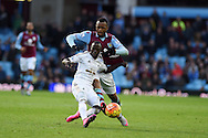 Jordan Ayew of Aston Villa challenges  Modou Barrow of Swansea city. Barclays Premier league match, Aston Villa v Swansea city at Villa Park in Birmingham, the Midlands on Saturday 24th October 2015.<br /> pic by  Andrew Orchard, Andrew Orchard sports photography.