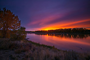 An autumn sunrise reddens the sky over the Missouri River at Coal Banks Landing in the Upper Missouri River Breaks National Monument in Montana.