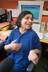 Disabled female meetings representative at work; Nottinghamshire Coalition for Disabled People (NCDP)