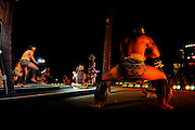 Polynesian dancers performing on stage, at night.<br /> Oahu, Hawaii