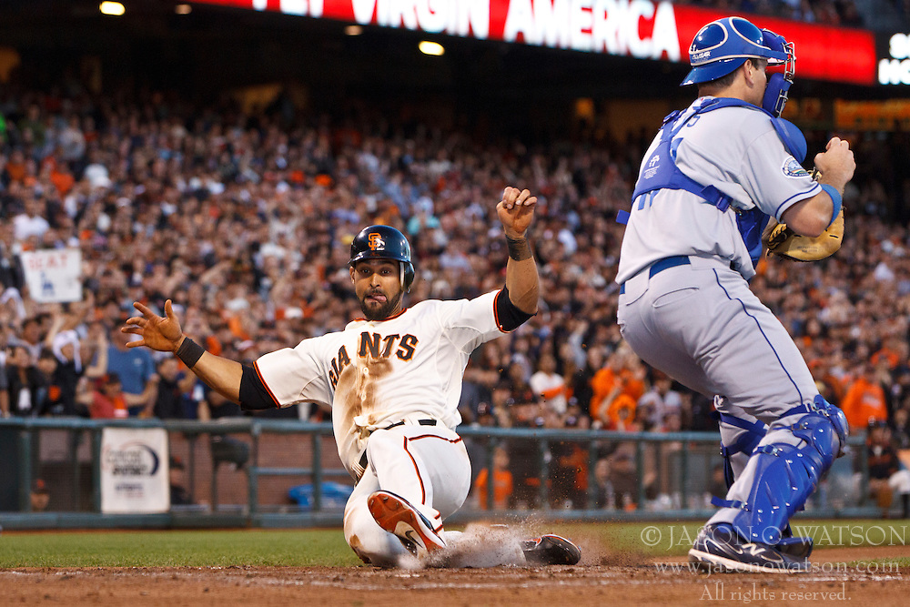 SAN FRANCISCO, CA - JUNE 26: Angel Pagan #16 of the San Francisco Giants slides into home plate past A.J. Ellis #17 of the Los Angeles Dodgers to score a run during the fourth inning at AT&T Park on June 26, 2012 in San Francisco, California. (Photo by Jason O. Watson/Getty Images) *** Local Caption *** Angel Pagan; A.J. Ellis