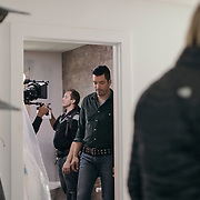 Jonathan Scott and crew prep to film a bathroom scene during a production day for the HGTV show, Brother vs Brother, Wednesday, February 15, 2017 in Galveston, Texas. Season five of the show which features The Property Brothers, Jonathan and Drew Scott, airs later this year.<br /> <br /> Todd Spoth for The New York Times.