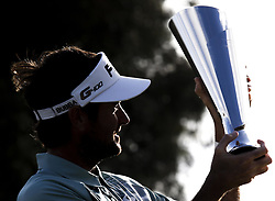 Bubba Watson holds the winner's trophy up after winning the PGA Tour Genesis Open golf tournament at Riviera Country Club in the Pacific Palisades area of Los Angeles, the United States Sunday, February 18, 2018. Watson won the Genesis Open. (Credit Image: © Zhao Hanrong/Xinhua via ZUMA Wire)