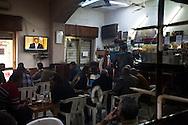 Men watch a speech by Obama on Al Jazeera in a cafe in Benghazi on March 4, 2011.