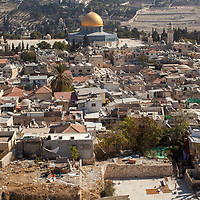 The golden roof of the Dome of the Rock on the Temple Mount in the Old City of Jerusalem is seen from above, the Mount of Olives is seen behind.