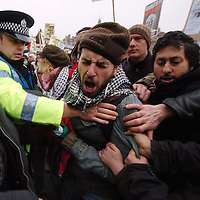 Protesters took to the streets of Edinburgh this afternoon, Saturday 10th January 2009 marching in support of the people of Gaza. ..Pic shows police trying to wrestle a Palestinian flag away from a protester...Picture Richard Scott/Maverick