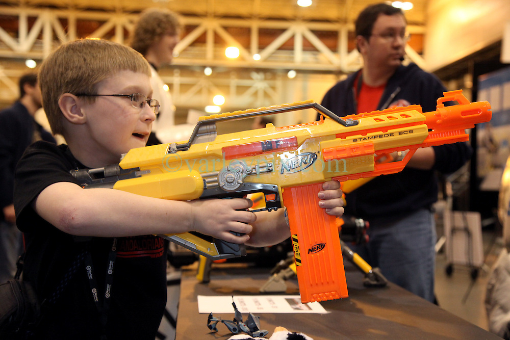 29 Jan 2012. New Orleans, Louisiana USA. <br /> Miles Estep (11 yrs)  takes aim at Star Wars and comic book characters gathered at the Wizard World New Orleans Comic Con at the Ernest N Morial Convention Center. <br /> Photo; Charlie Varley/varleypix.com