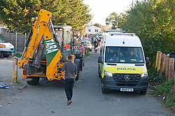 ©Licensed to London News Pictures 10/09/2020  <br /> Orpington, UK. A JCB digger arriving this morning to help move caravans. Police continue to search a traveller site in Orpington, South East London today after one of the biggest armed police operations in the UK. The site and local roads are under Met police control with a large cordon in place. Photo credit:Grant Falvey/LNP