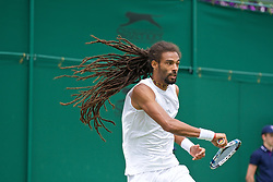 LONDON, ENGLAND - Tuesday, June 28, 2016: The dreadlocks of Dustin Brown (GER) during the Gentlemen's Singles 1st Round match on day two of the Wimbledon Lawn Tennis Championships at the All England Lawn Tennis and Croquet Club. (Pic by Kirsten Holst/Propaganda)