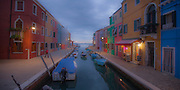 Colorful houses along a canal on the Island of Burano near Venice Italy