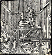 Ore which has been broken up in a stamping mill being reduced further by passing through a grinding mill.  The mill is driven by a water wheel, out of the picture to right, through axle, A.  Told and tin ore were treated in this way. From 'De re metallica', by Agricola, pseudonym of Georg Bauer (Basle, 1556).  Woodcut