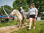 27 JUNE 2019 - CENTRAL CITY, IOWA: The pony ride at the Linn County Fair. Summer is county fair season in Iowa. Most of Iowa's 99 counties host their county fairs before the Iowa State Fair, August 8-18 this year. The Linn County Fair runs June 26 - 30. The first county fair in Linn County was in 1855. The fair provides opportunities for 4-H members, FFA members and the youth of Linn County to showcase their accomplishments and talents and provide activities, entertainment and learning opportunities to the diverse citizens of Linn County and guests.      PHOTO BY JACK KURTZ